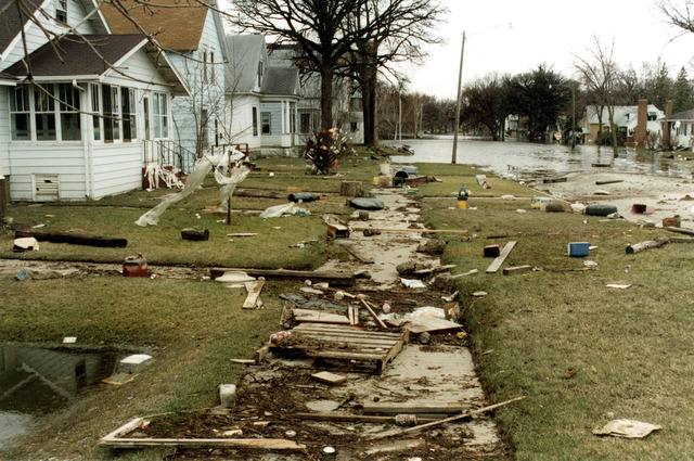 [Severe Storms/Flooding] East Grand Forks, MN, 04/30/1997 -- As the water finally recedes debris, that was carried by the water, litters neighborhoods. FEMA/Dave Saville