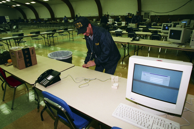 [Severe Storms/Flooding] Grand Forks, ND, April, 1997 -- A FEMA Mobile Emergency Response Support (MERS) worker sets up a Recovery Center in Grand Forks. FEMA/Michael Rieger
