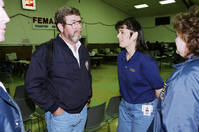 [Severe Storms/Flooding] Grand Forks, ND, April, 1997 -- FEMA workers Ken Jordan and Lesli Rucker at a recovery Center in Grand Forks ND.  FEMA/Michael Rieger