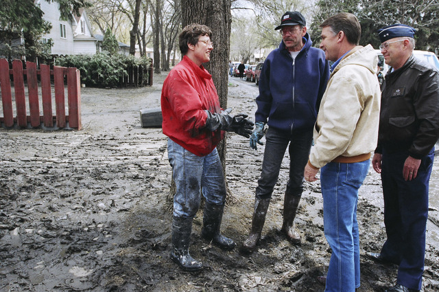[Severe Storms/Flooding] Grand Forks, ND, April, 1997 -- FEMA's Director, James Lee Witt, talks with residents who are mucking out their homes after the Red River of the North flooded the area.  FEMA/Michael Rieger