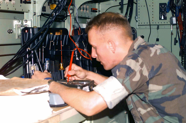 Corporal K. J. Childs, a radio technician with Maintenance Detachment, CSSD-27 (bat Service Support Detachment), repairs an RT-1209 (High Frequency Receiver/Transmitter) at the Electronics Maintenance pound during COMBINED ARMS Exercise (CAX) 6-97. CAX 5/6-97 is a MAGTF (Marine Air Ground Task Force) exercise being conducted at MCAGCC (Marine Corps Air Ground bat Center), 29 Palms, California. The command element for this exercise is MAGTF-6, which is built around the 6th Marine Regiment, 2d Marine Division, Camp Lejeune, North Carolina. Many commands from the II MEF (Marine Expeditionary Force) have sent units to this desert warfare exercise, to fill key billets in the Ground...