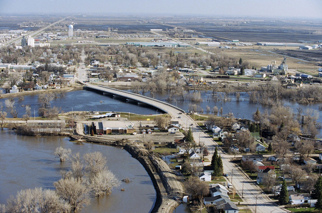 [Severe Storms/Flooding] Grand Forks, ND, April, 1997 -- Aerial view of a neighborhood in Grand Forks and the flooded Red River. FEMA/Michael Rieger
