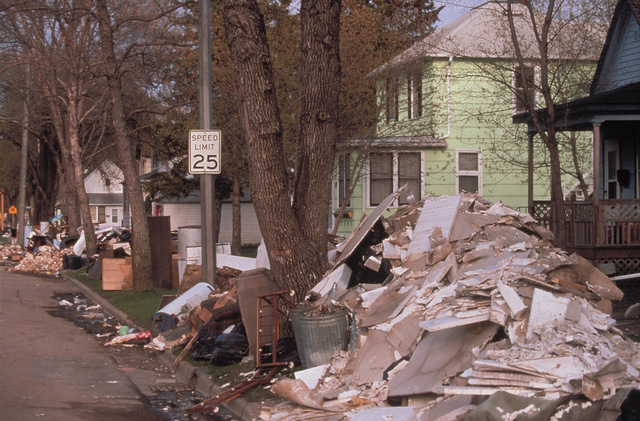 [Severe Storms/Flooding] Grand Forks, ND, May 01, 1997 -  Debris builds up as residents muck out their homes. FEMA/Michael Rieger