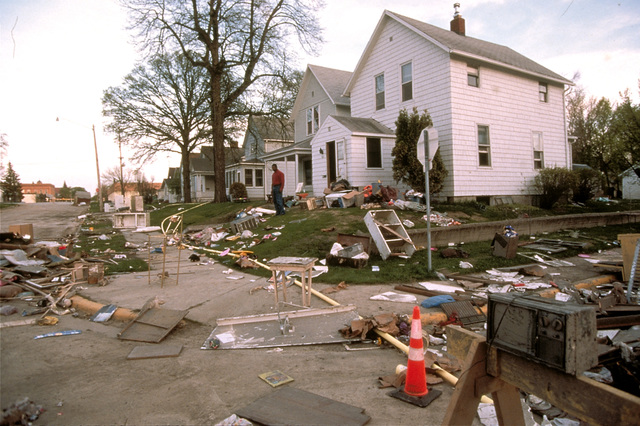 [Severe Storms/Flooding] Grand Forks, ND, May 1, 1997 -  Debris builds at the curbs as residents muck out their homes. Red River flood waters damaged many area homes. FEMA/Michael Rieger