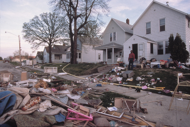 [Severe Storms/Flooding] Grand Forks, ND, May 1, 1997 -- Debris from the interior of homes now lines the streets and residents wait for it's removal to a site or landfill.  Many area homes were damaged as water from the Red River entered their homes.  FEMA/Michael Rieger