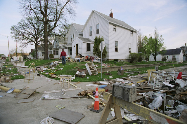 [Severe Storms/Flooding] Grand Forks, ND, May 1997 -- Trash builds up on the street as residents of Grand Forks muck out their homes.  FEMA/Michael Rieger