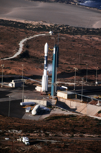 An aerial view of the Delta II rocket prior to lift-off at Space Launch Complex 2. The rocket was carrying the first 5 of the 66 Iridium satellites that will make up the Iridium satellite constellation allowing people to communicate with anyone, anytime, anyplace on earth