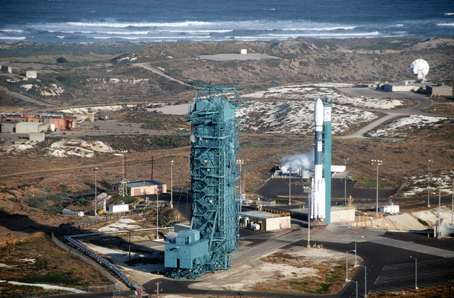 An aerial view of the Delta II rocket prior to lift-off at Space Launch Complex 2. The rocket is carrying the first 5 of the 66 Iridium satellites that will make up the Iridium satellite constellation allowing people to communicate with anyone, anytime, anyplace on earth