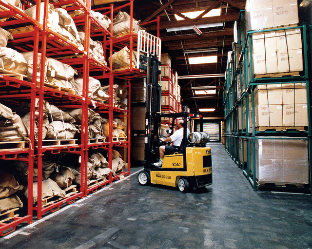 Yermo Annex. A propane operated forklift, operated by civilian warehouse personnel stacks logistical supplies at one of many large Defense Logistics Agency (DLA) Warehouses