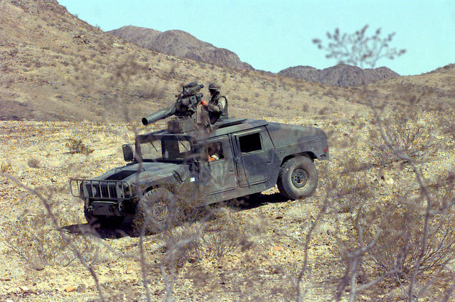 US Marine Corps Air Ground Combat Center (MCAGCC). A wire guided Tube Launched Optically (TOW) sighted missile on its High-Mobility Multipurpose Wheeled Vehicle (HMMWV), during Combined Arms Exercise (CAX) 5-97