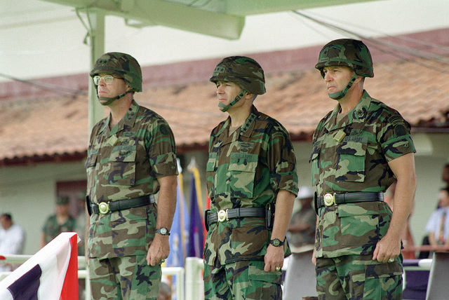 MAJ. GEN. Lawson W. Magruder, III (left), General Wesley K. Clark (center) and Brig. GEN. Philip R. Kensinger, Jr., (right), stand at attention during the pass in review at the Change of Command Ceremony