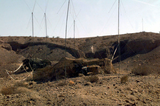 "US Marine Corps Air Ground Combat Center (MCAGCC). An ""Ant Hill"", or communications antenna array farm is cleverly camouflaged in the Quaken Bush Training Area, during Final Exercise (FINEX), part of Combined Arms Exercise (CAX) 6-97"