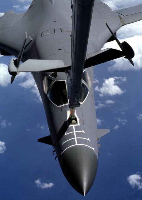 A USAF B-1 Lancer aircraft connects to the refueling probe of a KC-10 Extender aircraft from McGuire AFB, New Jersey during refueling operations, part of Exercise HORNETS NEST