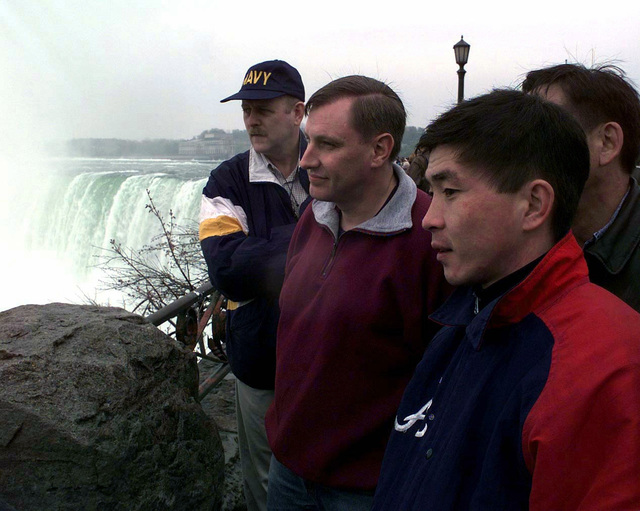 """Captain Brian Colgate, Public Affairs Officer (PAO), Air Transport Group Headquarters, Canadian Forces Base Trenton, Major Walt Thorpe, PAO, United States Atlantic Command, and Major Talaibek Oussoubaliev, Department of International Military Cooperation, Kyrgystan, take in the scenery at Niagara Falls, Canada, during the cultural exchange portion of Exercise COOPERATIVE ZENITH '97 (CZ'97). CZ'97 is one in a series of NATO sponsored """"Partnership for Peace"""" exercises, designed to expand political and military cooperation and understanding throughout Europe in the areas of peacekeeping, search and rescue and humanitarian operations"""