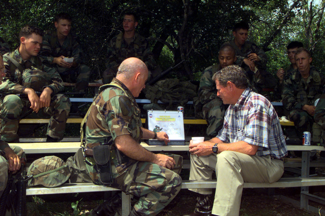 MGEN Leon Laport, Commander 1ST Cavalry Division, goes over battle plan for Task Force XXI (TFXXI) exercise with Senator James Inhofe, Chairman, Readiness Subcommittee of the Senate Armed Force Committee. Senator Inhofe was on hand to observe the training