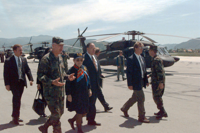GEN William W. Crouch, Commander, Stabilization Force, escorts U.S. Secretary of State Madeleine Albright to a waiting AH-60 Black Hawk (Blackhawk) helicopter for an aerial tour of the city during her visit
