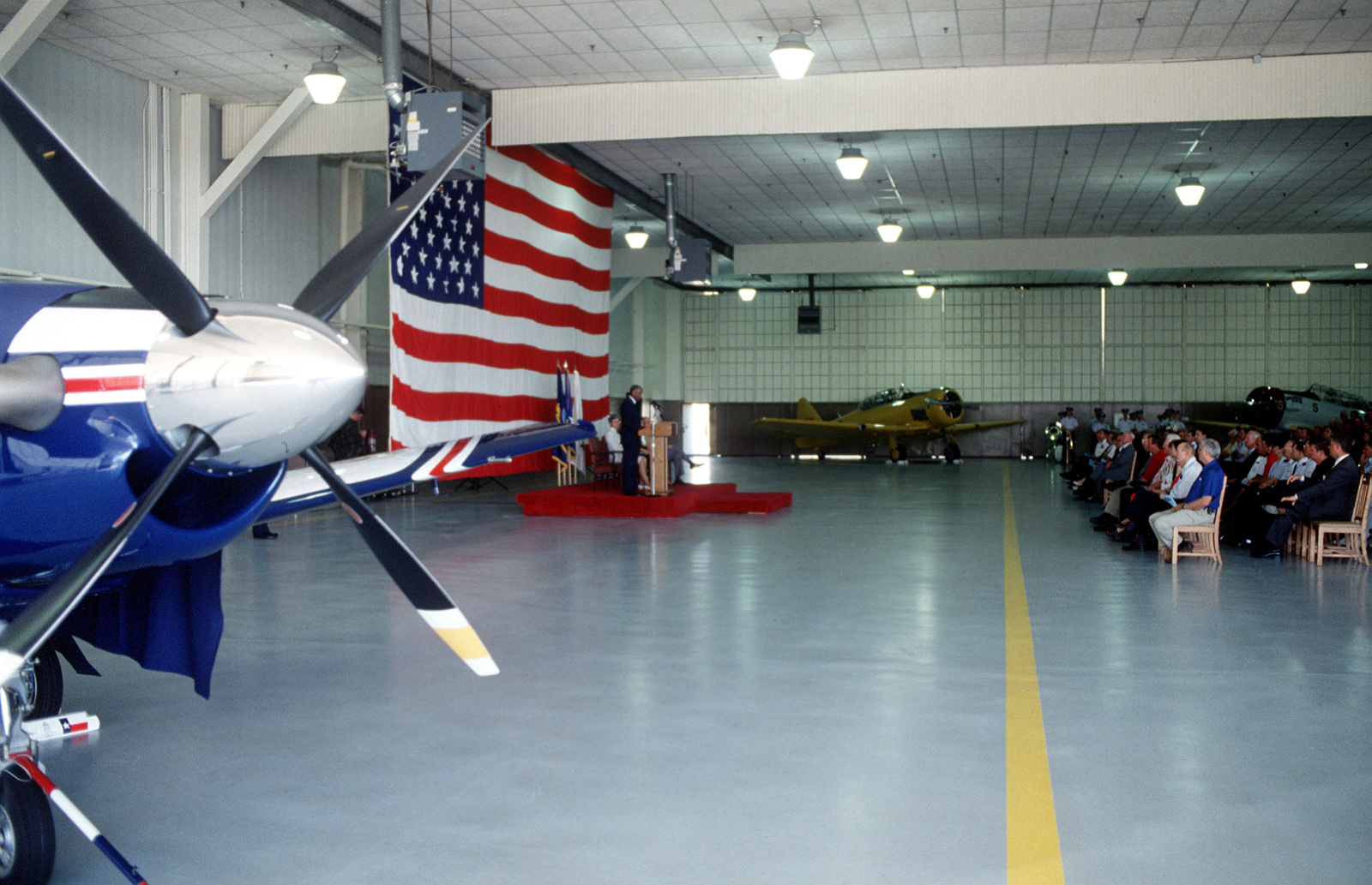 "General Lloyd ""Fig"" Newton, Air Education and Training Command Commander, and Vice Admiral Patricia Tracey, CHIEF of Naval Education and Training, Naval Air Station, Pensacola, FL, unveils the T-6A Texan II in Hangar 4. The T-6A Texan II will replace the Air Force's T-37 and the Navy's T-34 as the Joint Primary Trainer for both services. The 12th Flying Training Wing receives it first Texan II on May 1999"
