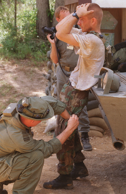 A suspect is being searched after being captured by Partnership for Peace soldiers during an exercise at the Joint Readiness Training Center