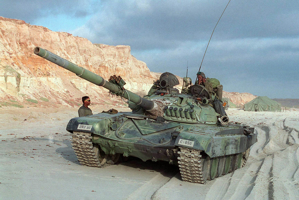 Marines from the 1ST Marine Division, 3rd Amphibious Armored Vehicle Battalion add realism to the exercise by driving a former Soviet bloc T-72 main battle tank across the beach head. These Marines are acting as the opposing force, commonly called the OPFOR