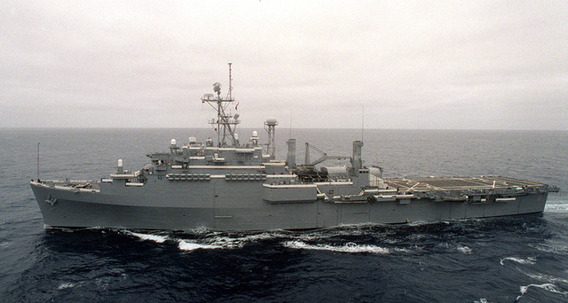 The Flag Ship USS CORONADO (AGF-11) passes the USS TARAWA (LHA 1) performing leapfrog manuevers, during Exercise KERNEL BLITZ '97 off the Southern California coast. KERNEL BLITZ is a biannual Commander-in-CHIEF Pacific (CINCPAC) fleet training exercise (FLEETEX) focused on operational/tactical training of Commander, Third Fleet (C3F)/ I Marine Expeditionary Forces (MEF) and Commander, Amphibious Group 3 (CPG-3)/ 1ST Marine Division (MARDIV). KERNEL BLITZ is designed to enhance the training of Sailors and Marines in the complexities of brigade-size amphibious assault operations