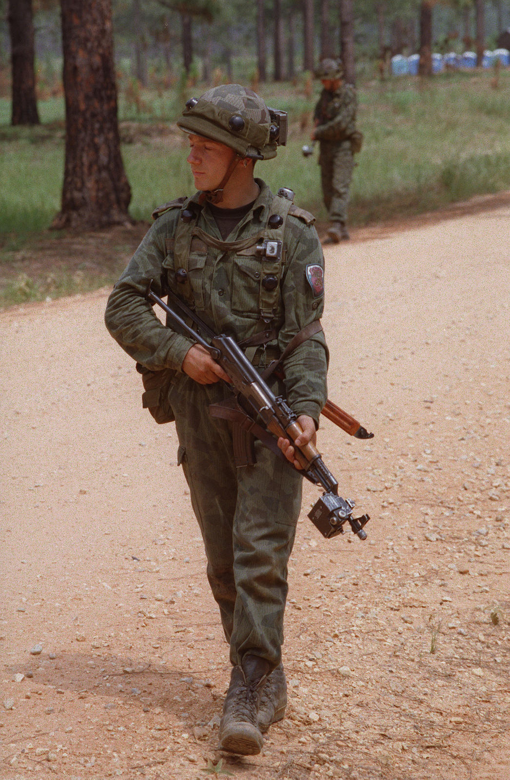 A Partnership For Peace soldier, armed with an AK-47 rifle