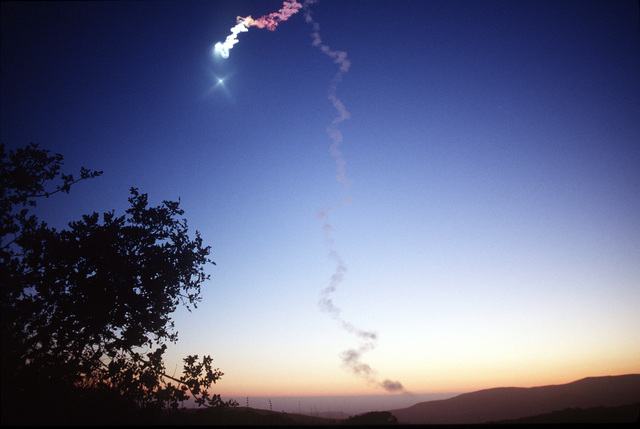 """A reconfigured Minuteman II intercontinental ballistic missile was launched from Vandenberg AFB at 8:39 p.m. 23 June 1997. The missile, part of the Multi-Service Launch System developed by Lockheed-Martin Astronautics, deployed a payload of nine target objects in space to test sensors carried aloft by a second Minuteman II that was launched from the Kwajalein Missile Range in the south Pacific Ocean approximately 20 minutes later. It carried sensors using existing National Missile Defense technology to identify and track the nine target objects released by the Vandenberg missile. A side effect from the launch resulted in what is termed as a """"twilight phenomenon,"""" a multicolored light..."""