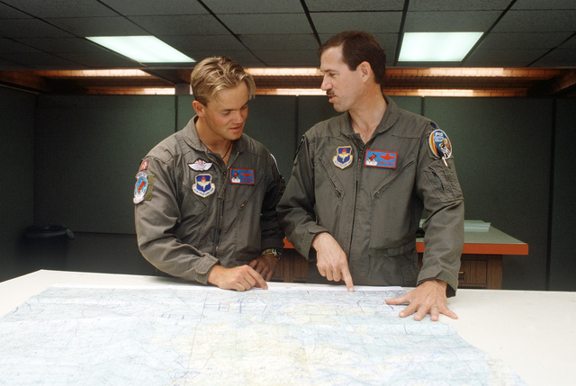 Air Force LTC Scott Cole (right) from the 138th Fighter Wing, Minnesota Air National Guard, briefs a Norwegian pilot on flight conditions