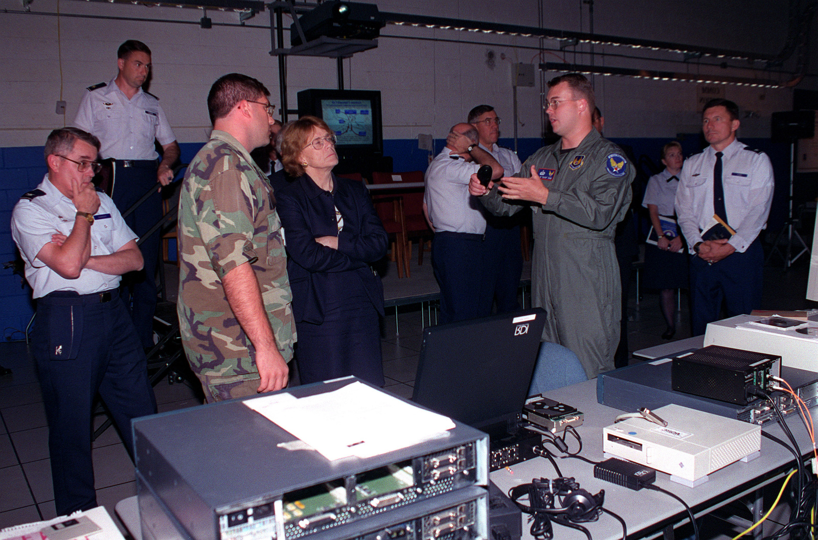 The Honorable Dr. Shiela Widnall, Secretary of the Air Force and Massachusetts native, visits the base and tours the Combined Unified Battlespace Environment (CUBE) located in the Electronic Systems Center (ESC). Project officer CPT Brock explains to Madam Secretary, the mission of the CUBE