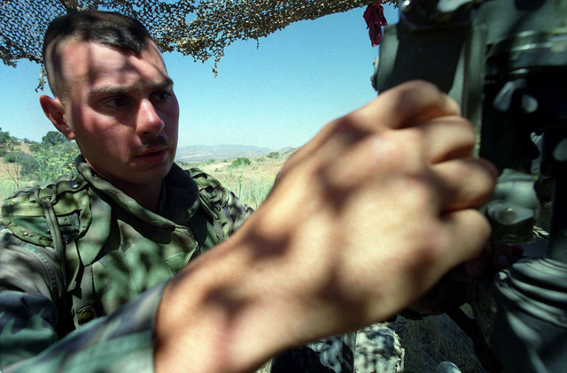 Marine Private First Class Antony Luna of B Battery, 1ST Battalion prepares range settings on a Howitzer prior to its firing in support of Exercise KERNEL BLITZ '97. The exercise largely taking place off the coast of Southern California and Camp Pendleton, is designed to enhance the training of Sailors and Marines in the complexities of brigade-size amphibious assault operations
