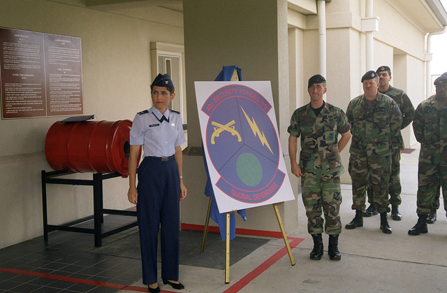COL Sally Ubelacker (left), 42nd Support Group commander, assists in the unveiling of the new emblem for the 42nd Security Forces Squadron which was formerly known as the 42nd Security Police Squadron