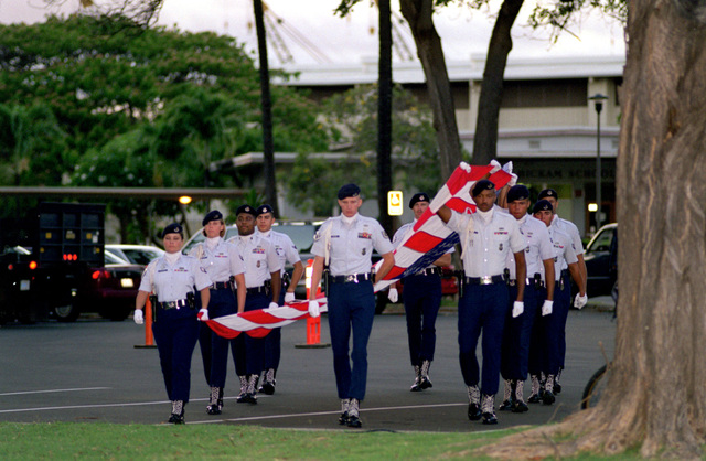 Members of the 15th Wing Honor Guard prepare to execute the pass and review at the Hickam Air Tattoo. Distinguished guests include the Honorable Dr. Sheila Widnall, Secretary of the Air Force