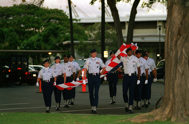 Members of the 15th Wing Honor Guard prepare to execute the pass and review at the Hickam Air Tattoo