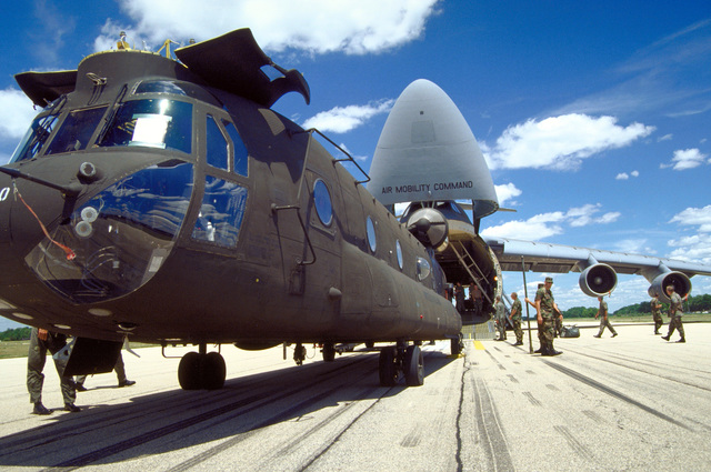An Army National Guard CH-47D Chinook helicopter from Detachment 1, Company F, 106th Aviation Davenport, Iowa is loaded into a 436th Airlift Wing, 3rd Airlift Squadron's C-5B Galaxy airlifter. The Chinook is on its way to Georgetown, Guyana in support of New Horizon '97, the first combined humanitarian and civic assistance exercise conducted between the United States and Guyana. Military personnel from the Air Force, Air Force Reserve & National Guard, Army, Army National Guard and Marine Corps participated in the exercise which included engineering and medical readiness training