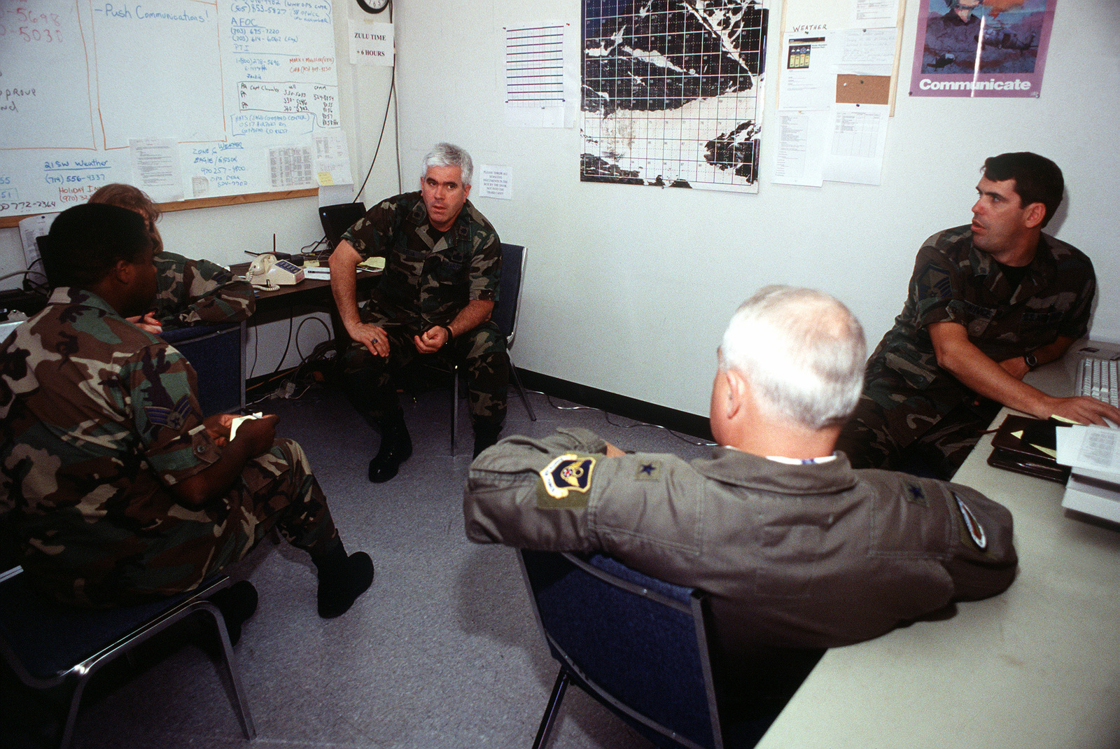 LTCOL Mike Selva (center, left), on-scene commander, briefs BGEN Donald A. Streater (foreground, right), commander of the A-10 recovery operation, on the pararescuemen's progress at the crash site near Gold Dust Peak. LTCOL Selva is assigned to Peterson Air Force Base, Colorado and BGEN Streater is assigned 8th Air Force, Barksdale Air Force Base, Louisiana