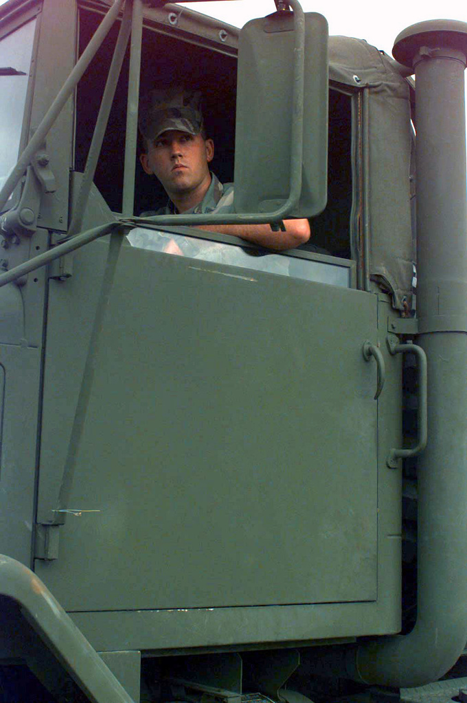 """A Marine from 8th Motor Transport Battalion backs off a M923 5-ton cargo truck from the MV Villars at the port facility in Paldiski, a. The Villars had brought equipment stored in Norway under the Norway Air-Landed Marine Expeditionary Brigade (NALMEB) program to a for BALTIC CHALLENGE '97. BALTIC CHALLENGE is a multinational exercise conducted in the spirit of NATO's Partnership for Peace (PfP) initiative. More than 2600 military personnel from Denmark, a, Finland, Latvia, Lithuania, Norway, Sweden, and the US, will participate in the second """"in the spirit of PfP"""" land exercises conducted in the Baltic region. Co-Commanders for the exercise being held in Paldiski,..."""