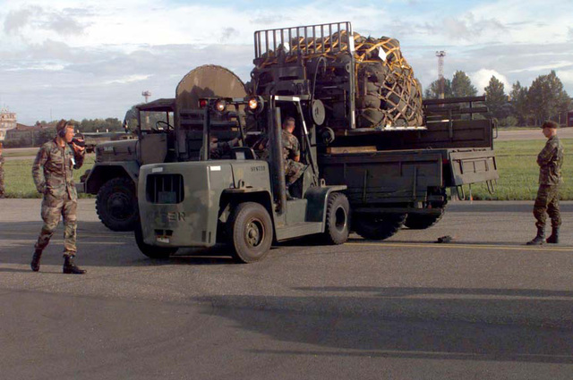 An US Air Force forklift operator places a pallet of Marine Corps equipment onto an Estonian Army truck at the airport. Baltic Challenge '97 is a multinational exercise conducted in the spirit of NATO's Partnership for Peace (PfP) initative. More than 2600 military personnel from Denmark, Estonia, Finland, Latvia, Lithuania, Norway, Sweden, and the USA will participate in the second PfP land exercise conducted in the Baltic region. While this exercise will conduct training along peacekeeping/humanitarian assistance mission standards, significant US Navy and Marine Corps capabilities never exercised in Europe will be performed including the use of equipment from the US Marine Corps Norway ...