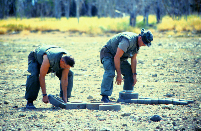 Minefield maintenance Marines stack mines for disposal. Naval Station Guantanamo Bay, Cuba, is clearing it's minefields of outdated mines in accordance with President William Jefferson Clinton's directive
