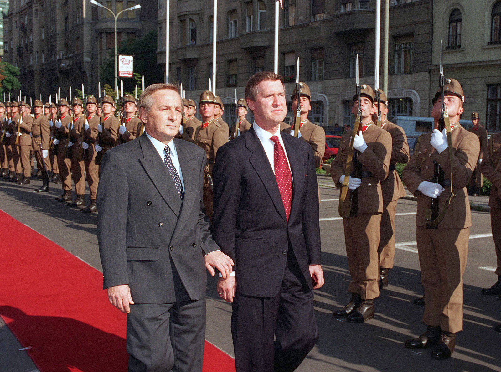 Secretary of Defense William Cohen (right) inspects the honor guard assembled outside the Ministry of Defense Building in Budapest, Hungary, July 10, 1997. Escorting Cohen is Hungarian Defense Minister Gyorgy Keleti (left). Secretary Cohen visited Hungary immediately following the NATO summit in Madrid, Spain, where Hungary, along with Poland and the Czech Republic were offered membership in the Western military alliance. During meetings, Keleti warned Cohen that it could take his nation eight to 10 years to upgrade its Soviet-style military to achieve compatibility with other NATO forces