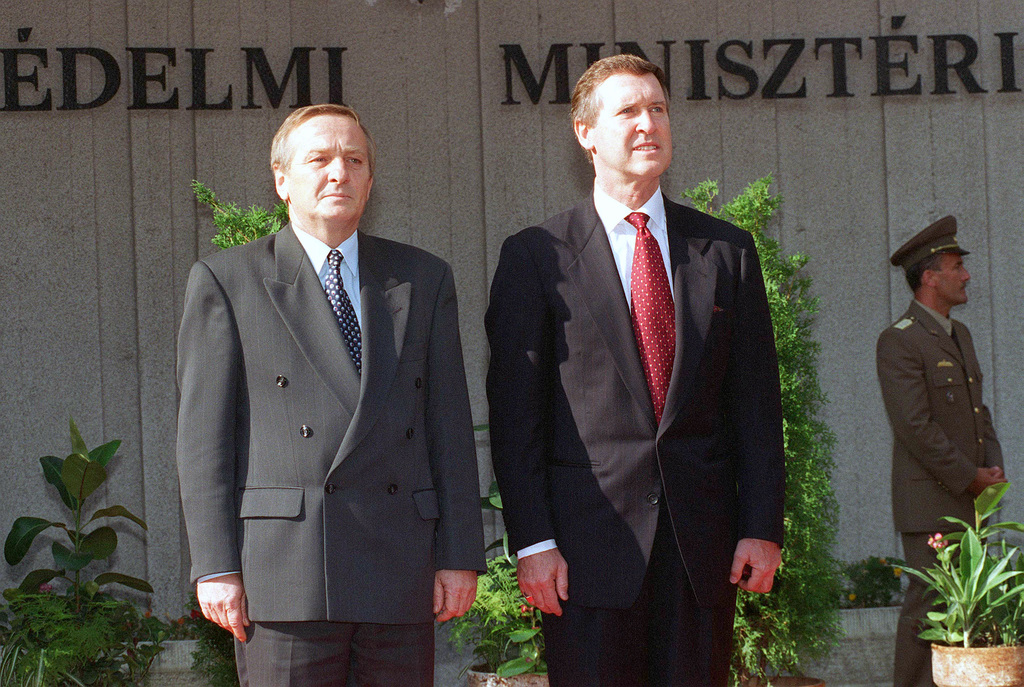 Secretary of Defense William Cohen (right) stands with Hungarian Defense Minister Gyorgy Keleti (left) as military honors are rendered during welcoming ceremonies in Budapest, July 10, 1997. Cohen visited Hungary, in part, to congratulate them on being selected as one of the three former Soviet Bloc nations to be offered NATO membership at the just completed NATO summit held in Madrid, Spain. The other part of his message was that much remains to be done to insure that Hungary is capable of assuming the responsibilities that accompany the privileges of NATO membership. Secretary Cohen held meetings with the nation's senior leadership to pledge US support for r efforts to modernize...