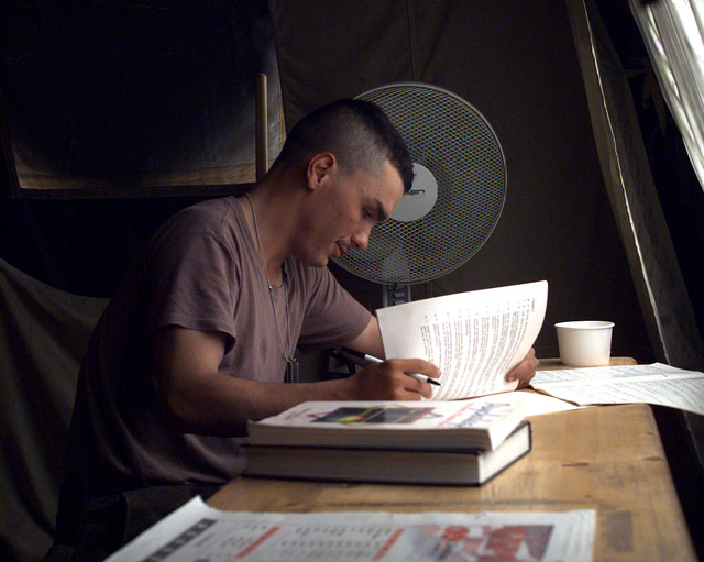 US Army, Private First Class (PFC) Randy Van Zandt, C Company, 2d Battalion, 2d Infantry, 3rd Brigade, 1ST Infantry Division (Mechanized), Vilseck, Germany, Task Force Eagle, does some studying in the library at Camp McGovern, Bosnia-Herzegovina. Operation JOINT GUARD, 10 July 1997