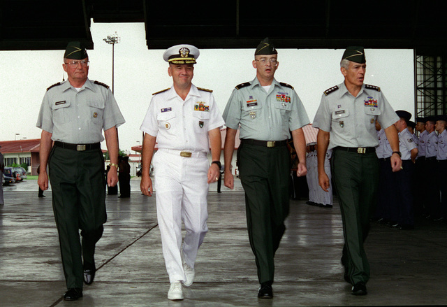 GEN. John M. Shalikashvili (far left), Rear Adm. Walter F. Doran (left center), Brig. GEN. Richard J. Quirk, III (right center), and GEN. Wesley K. Clark (far right), inspect the troops during the US Southern Command (USSOUTHCOM) Change of Command Ceremony