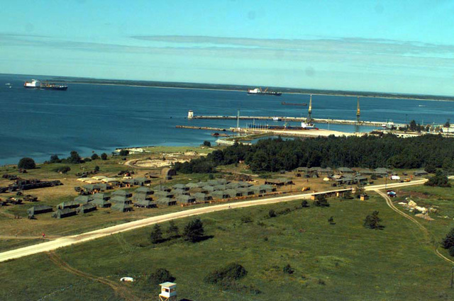 An aerial view of Camp Muffler, base camp of II Marine Expeditionary Force, Forward (II MEF FWD), with Maritime Pre-Positioning ships the SS Eugene A. Obregon, and the SS SGT. Matej Kocak anchored in the harbor. Baltic Challenge '97 is a multinational exercise conducted in the spirit of NATO's Partnership for Peace (PfP) initiative. More than 2600 military personnel from Denmark, Estonia, Finland, Latvia, Lithuania, Norway, Sweden, and the USA will participate in the second PfP land exercises conducted in the Baltic region. While this exercise will conduct training along peacekeeping/humanitarian assistance mission standards, significant US Navy and Marine Corps capabilities never ...