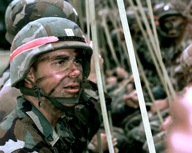 US Army, Private First Class (PFC) Walker, 82nd Airborne Division awaits a mock practice jump during a Joint Readiness Training Exercise (JRTX) being conducted at Fort Bragg, North Carolina, !5 July 1997