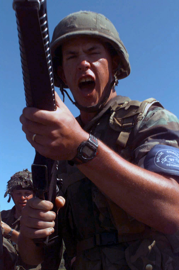 """Lance Corporal Mathew Cambell of 1ST Battalion, 25th Marines, shows his war face while practicing quick response force techniques during BALTIC CHALLENGE '97. BALTIC CHALLENGE is a multinational exercise conducted in the spirit of NATO's Partnership for Peace (PfP) initiative. More than 2600 military personnel from Denmark, Estonia, Finland, Latvia, Lithuania, Norway, Sweden, and the US, will participate in the second """"in the spirit of PfP"""" land exercises conducted in the Baltic region. Co-Commanders for the exercise being held in Paldiski, Estonia are Colonel Oscar Mark, Estonian Defense Forces and Colonel D. L. Andrews, US Marine Corps Reserve. While BALTIC CHALLENGE will conduct..."""
