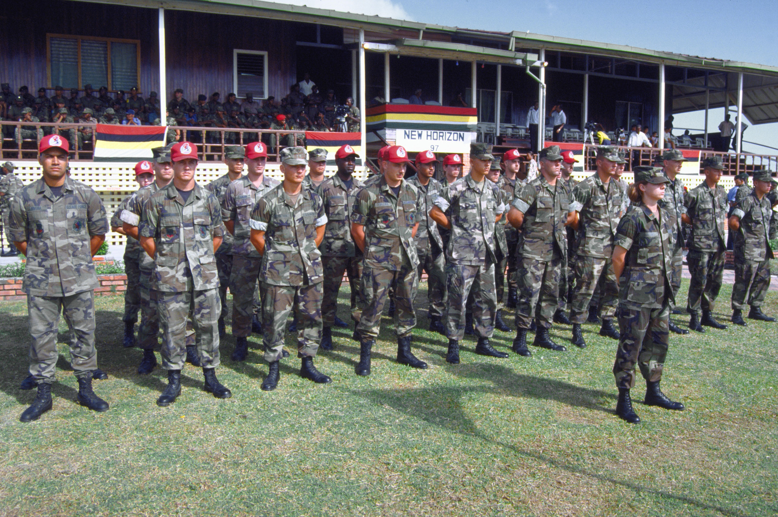 Military personnel from the Air Force, Air Force Reserve & National Guard, Army, Army National Guard and Marine Corps, comprising Combined Task Force Falcon, stand in formation during the opening ceremony, at Georgetown's National Services Sports Complex. New Horizon '97 is the first combined humanitarian and civic assistance exercise conducted between the United States and Guyana