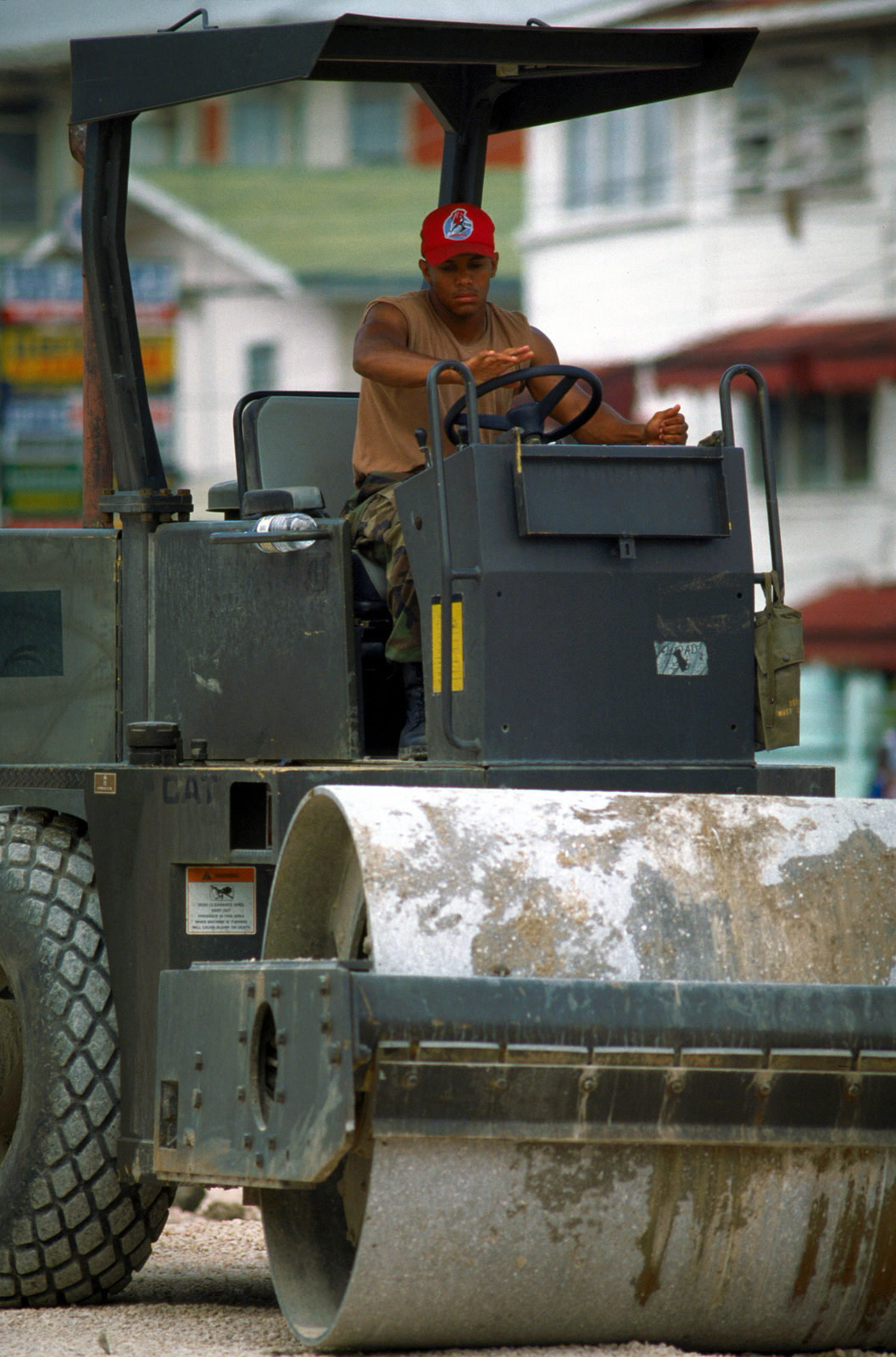 AIRMAN 1ST Class Tavares L. Lumplin, 820th Red Horse Squadron, Nellis Air Force Base, NV operates a steam roller at the site of the new St. Mary's Primary School. The school in Georgetown is being constructed during New Horizon '97, first combined humanitarian and civic assistance exercise conducted between the United States and Guyana. Military personnel from the Air Force, Air Force Reserve & National Guard, Army, Army National Guard and Marine Corps participated in the exercise which included engineering and medical readiness training