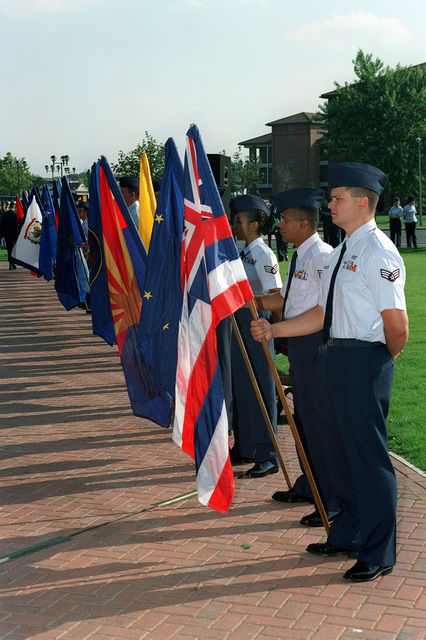 U.S. Air Force airmen display state flags along the walkway of the Wings of Liberty Park during ceremonies held at the park. The celebration was a joint venture between RAF Mildenhall and RAF Lakenheath personnel celebrating the 50th Anniversary of the U.S. Air Force