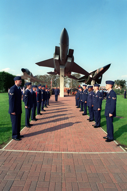 U.S. Air Force airmen line the walkway to the Wings of Liberty Park, recognizing the 50th Anniversary of the U.S. Air Force. The celebration was a joint venture between RAF Mildenhall and RAF Lakenheath personnel