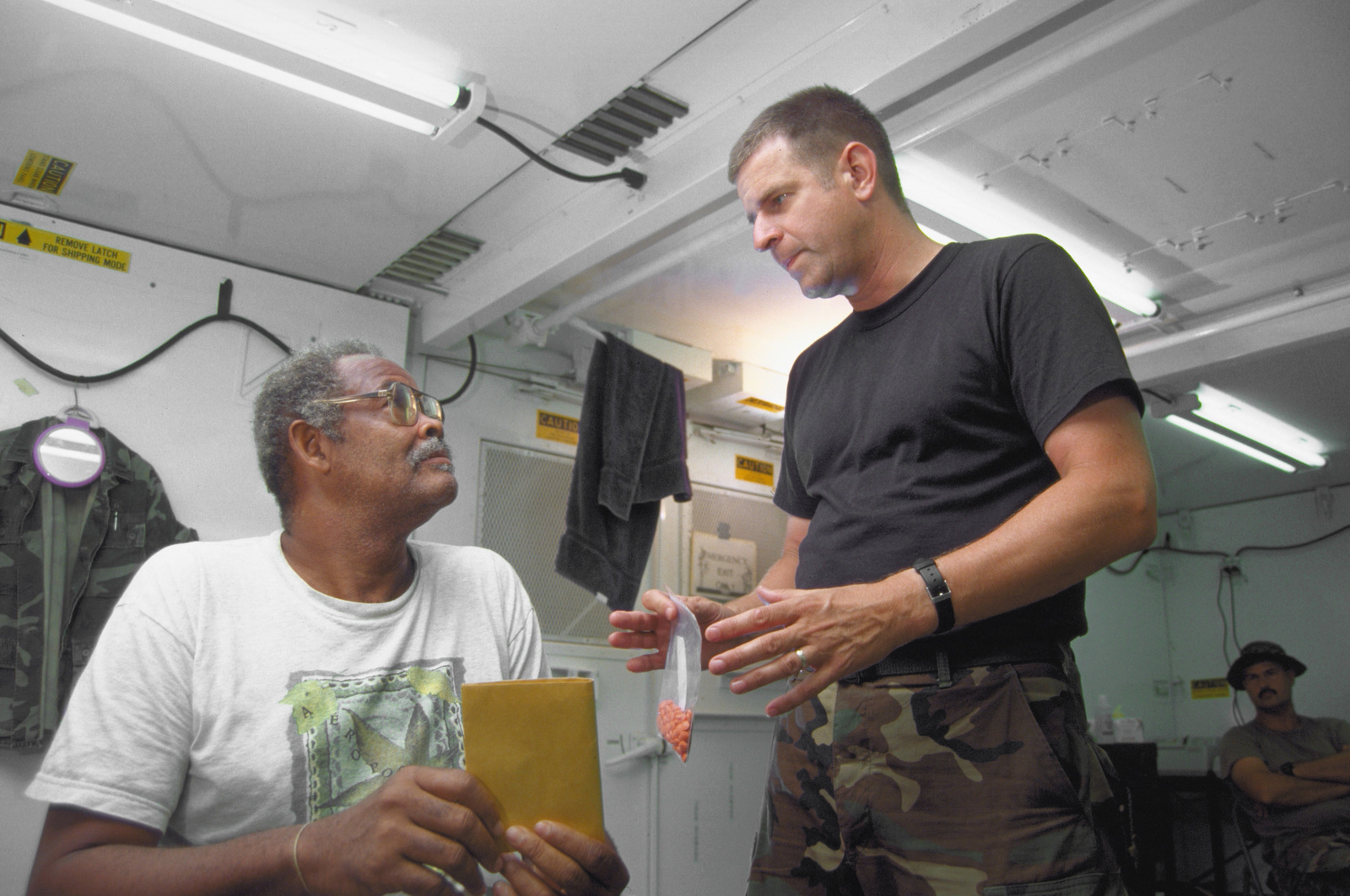 LT. COL. Stephen R. Holt, deployed commander of the 49th Medical Squadron, 2nd Echelon Medical facility, Holloman Air Force Base, N.M. speaks to a Guyanese patient. The 49th doctors provided medical care in this first combined humanitarian and civic assistance exercise conducted between the United States and Guyana. Military personnel from Air Force, Air Force Reserve & National Guard, Army, Army National Guard and Marine Corps participated in the exercise which included engineering and medical readiness training