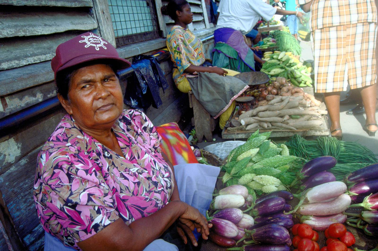 A Guyanese woman sells her fresh produce at Stabroek Market, a major indoor/outdoor shopping area in downtown Georgetown. Her produce was available for purchase by participants of New Horizon '97, first combined humanitarian and civic assistance exercise conducted between the United States and Guyana. Military personnel from the Air Force, Air Force Reserve & National Guard, Army, Army National Guard and Marine Corps participated in the exercise which included engineering and medical readiness training